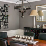 Dining room with modern geometric chandelier and wine rack